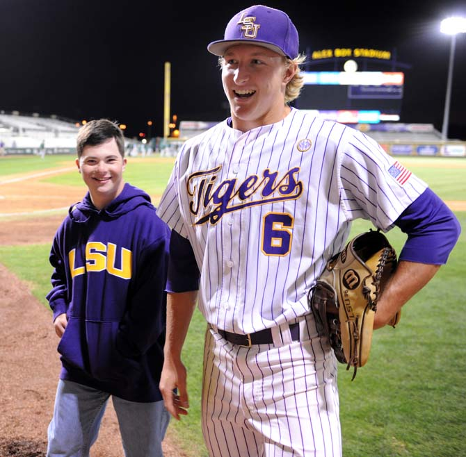 LSU freshman outfielder Andrew Stevenson (6) and his brother Matt take the field after the Tigers' 4-3 victory over Tulane at Alex Box Stadium. Photo by Richard Redmann