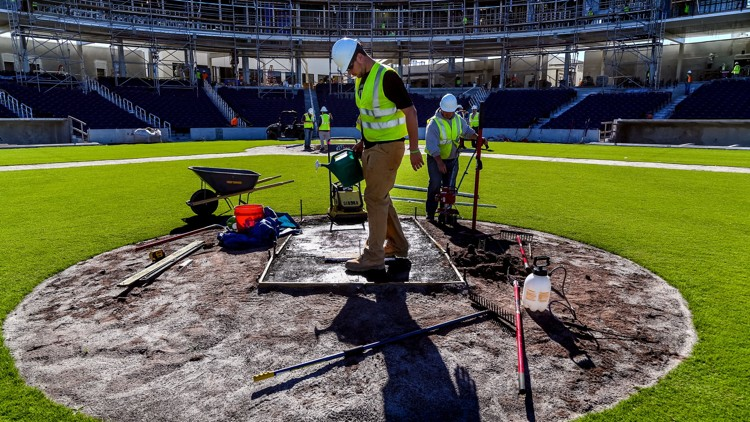 Cam Richardson, left, and Zach Severns, operations managers for BrightView Sports Turf, complete work on the stadium pitchers mound at the Ballpark of the Palm Beaches in West Palm Beach on January 10, 2017. (Richard Graulich / The Palm Beach Post)